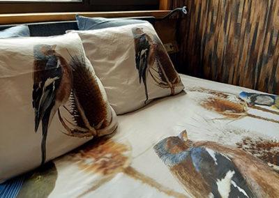 Heerlijk slapen onder een dekbedovertrek met vogeltjes