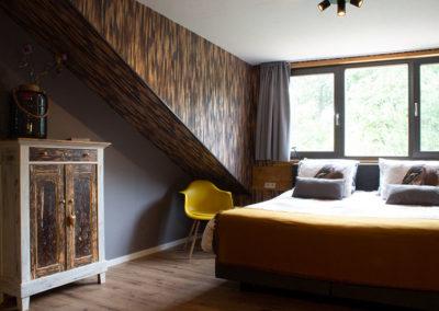 Slaapkamer met uitzicht over het Brabantse landschap